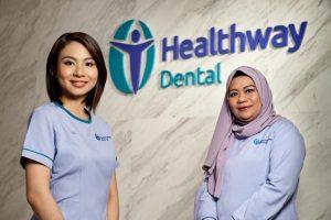 Healthway Dental Clinic staff standing in front of a Healthway Dental clinic in Singapore